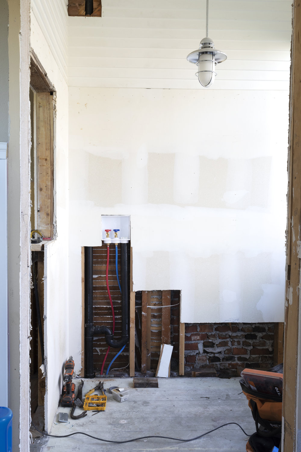 The Grit and Polish - Farmhouse Laundry Room Demo Plumbing.jpg