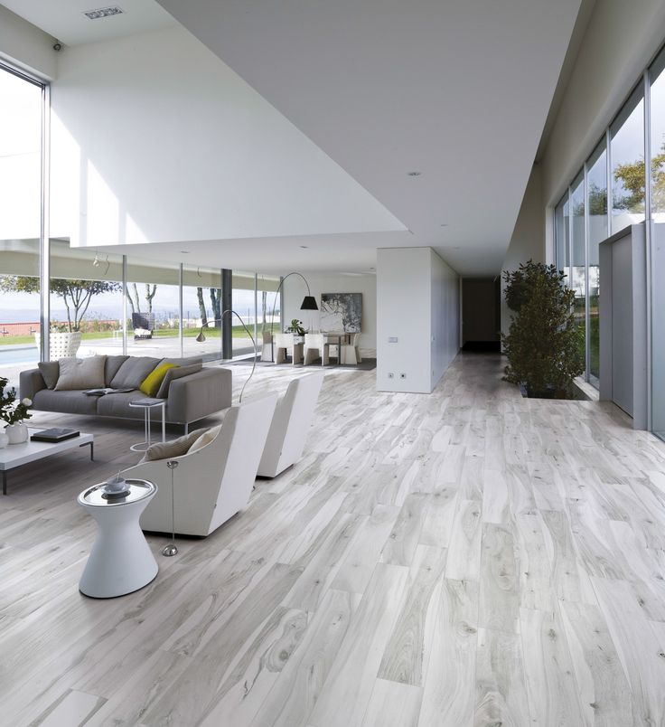 "Wood looking tile creates the ""cozy"" feel thanks to texture, colors and shapes."