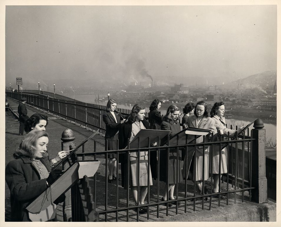 """Pennsylvania College for Women students sketching atop Mount Washington during Pittsburgh's """"Hell with the lid taken off"""" era."""