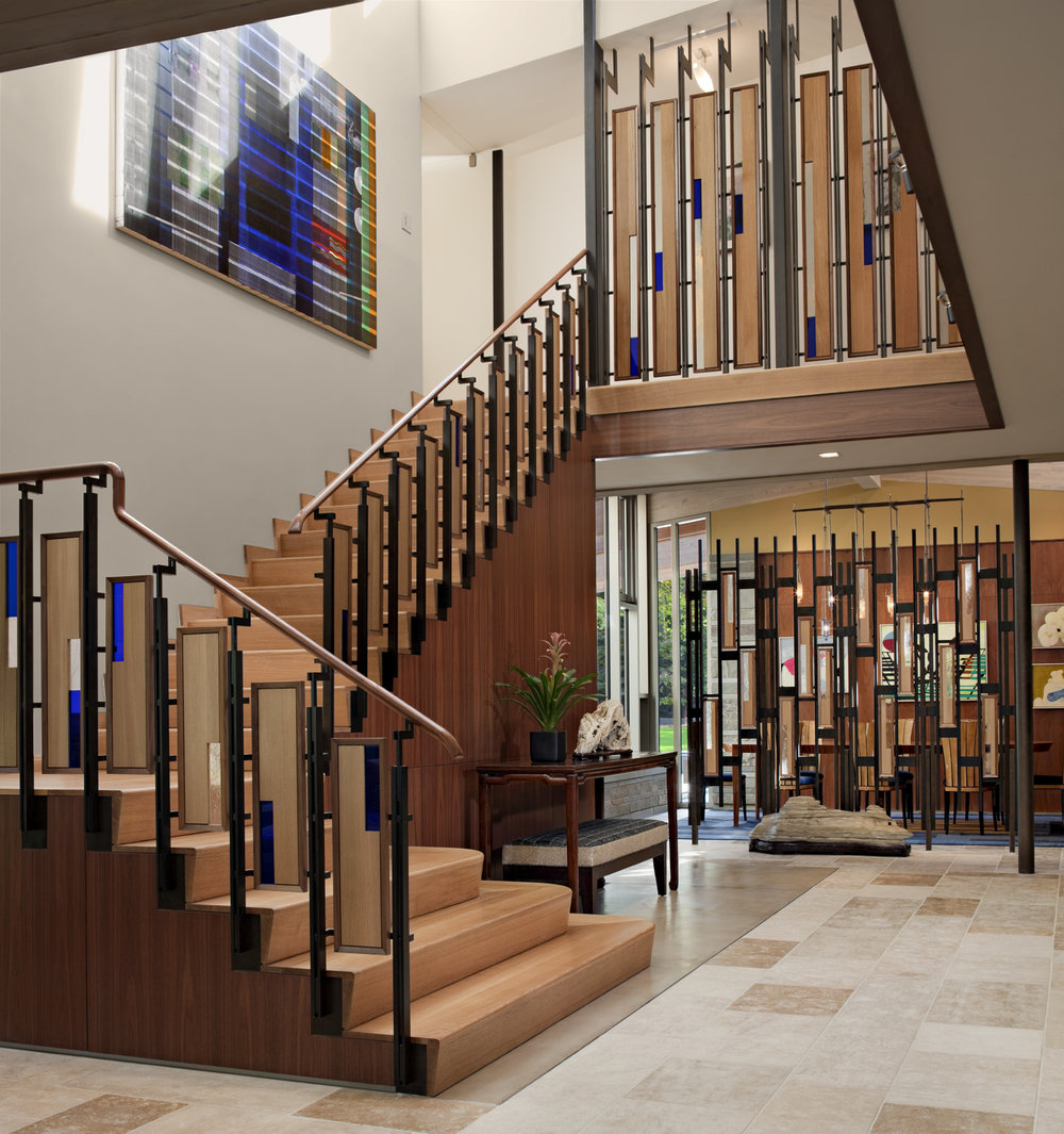 Stair clerestory acting as solar light, recirculating hot air, and hot water collector,    Floating Peak House