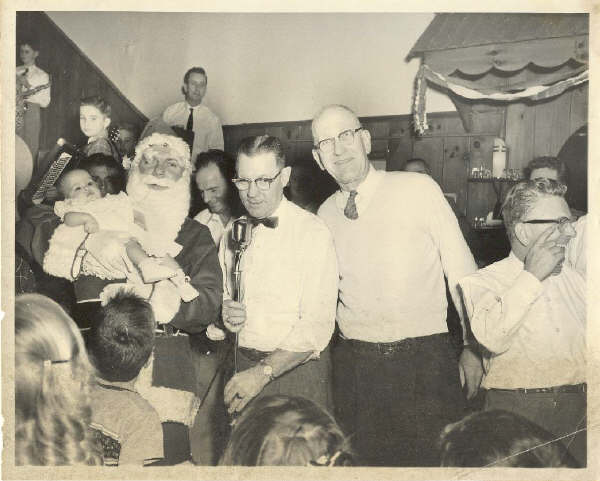 Find the Ambrose Quaile and Rivell in the QC Xmas Party photo.jpg