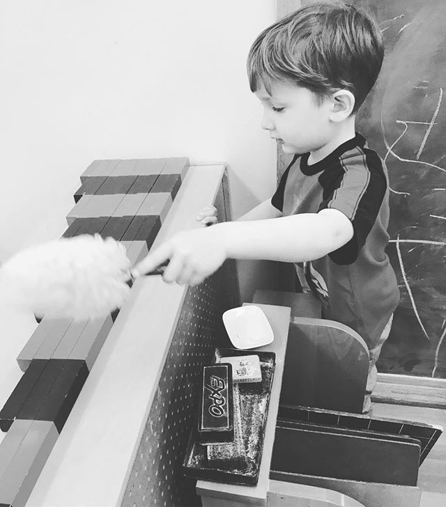Conducting his own experiences #waylandmontessori #montessori #newenglandmontessori #primary #preschool #dusting #shelves #numberrods #math #joy #youth