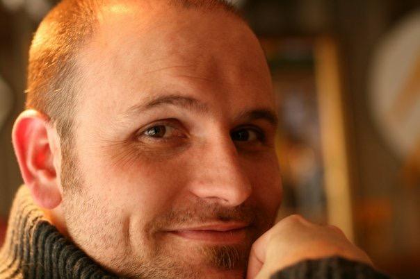 Greg posing for his novels headshot
