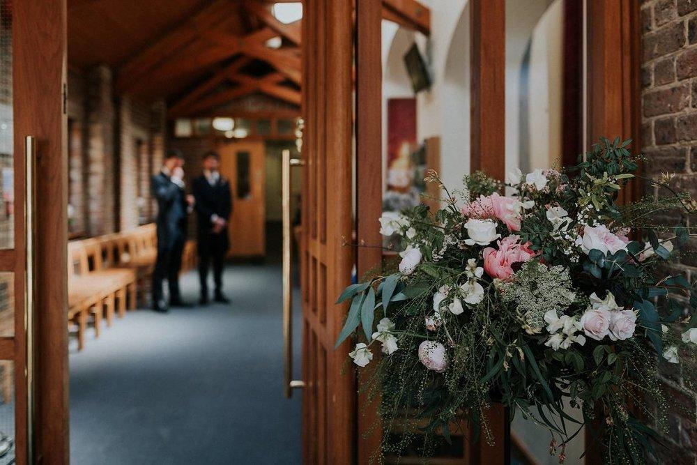 Pedestal flowers on church entrance