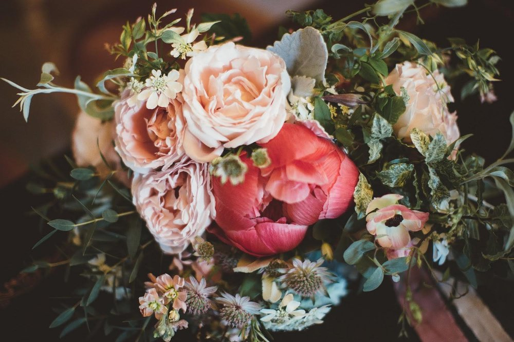 Bridal bouquet with coral peonies and peach roses