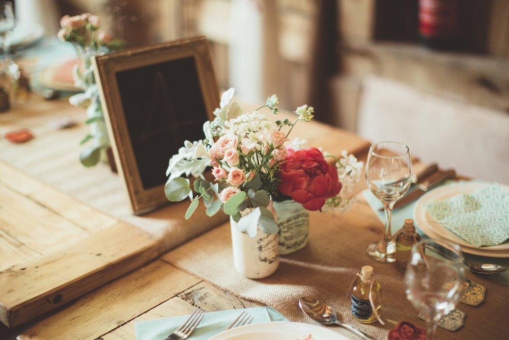 Wedding table with jam jars flowers