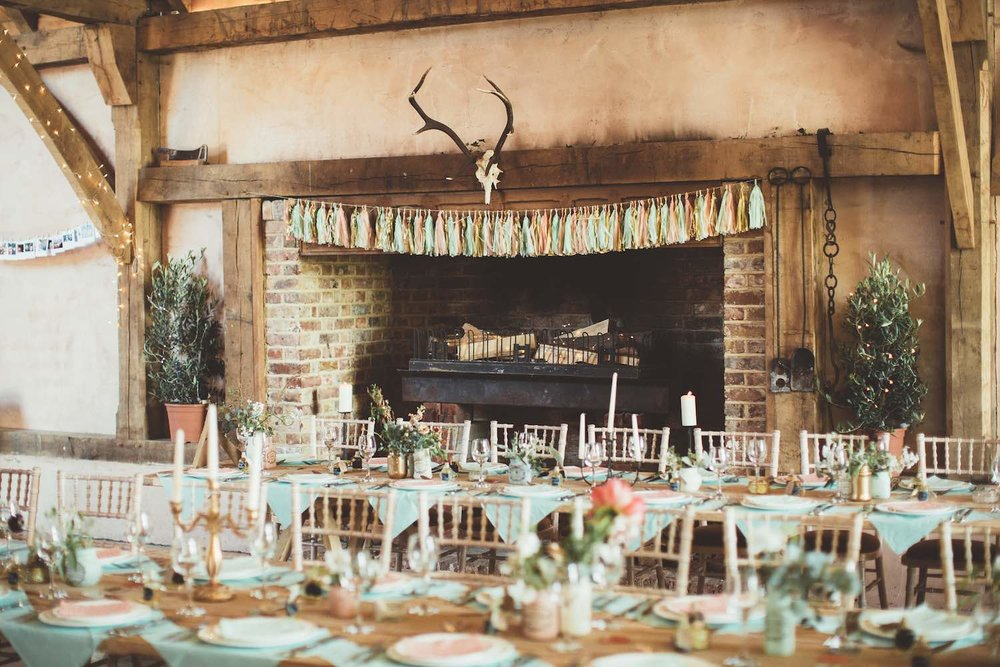 Barn with fireplace and wedding breakfast table setting