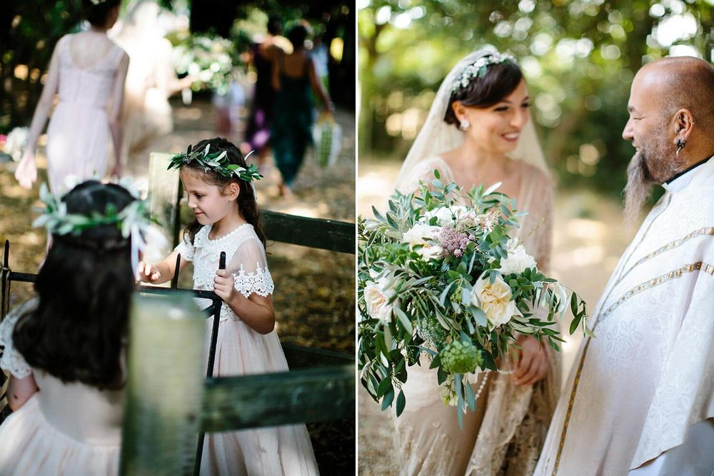 Flower girls with olive hair crowns by kissing gate and bride with white rose bouquet