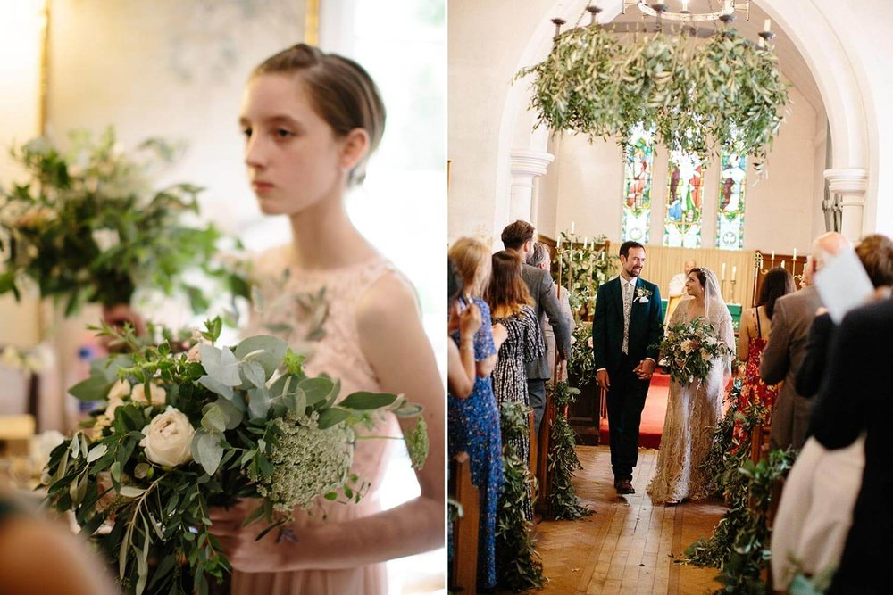 Bridesmaid with flowers and church with foliage chandelier and trailing aisle flowers