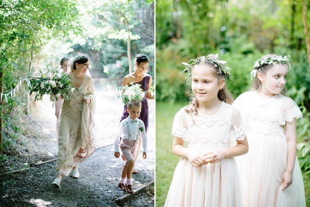 Bride and pageboy walking, flower girls with flowers
