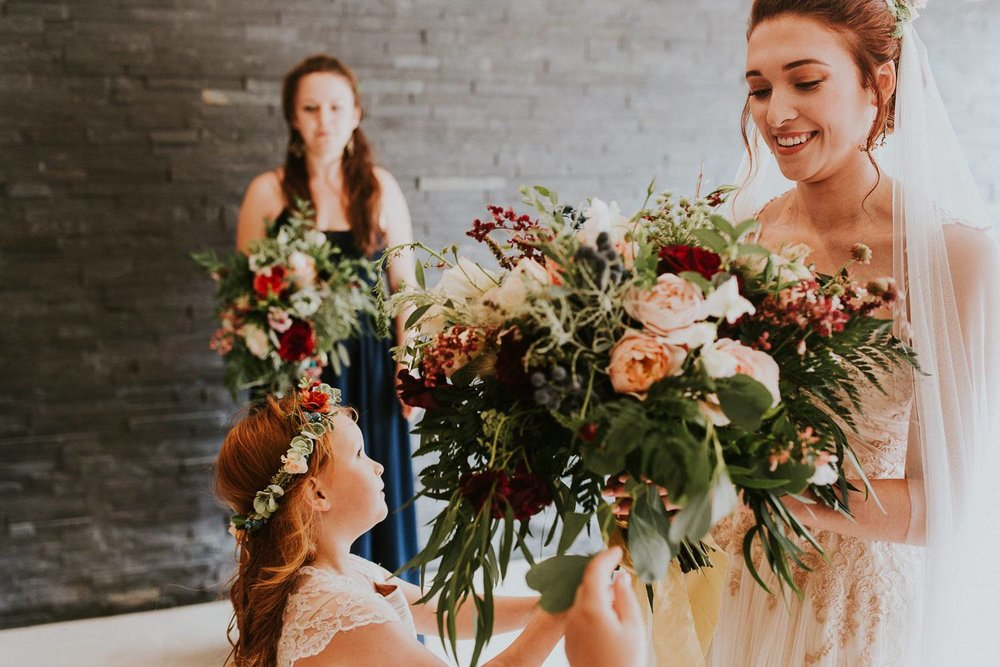 Bride and flower girl with woodland wedding bouquet