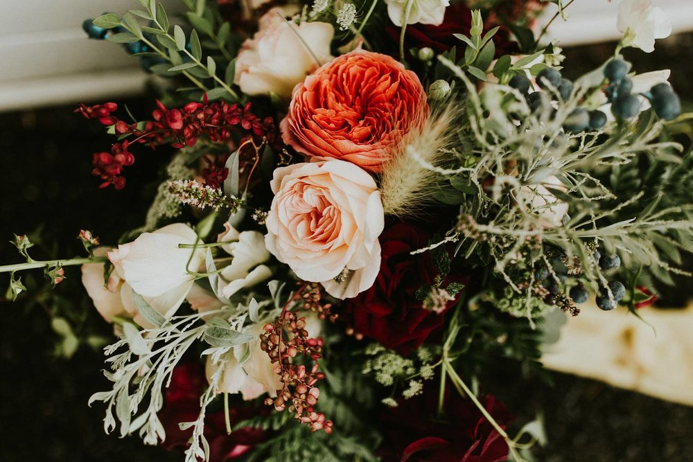 Late summer woodland bridal bouquet with roses