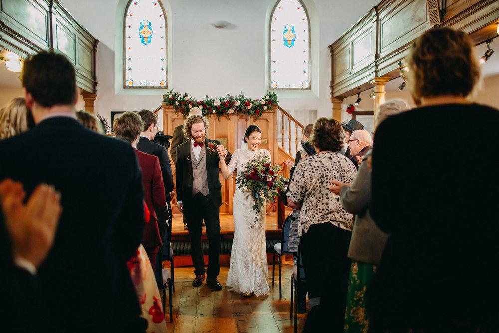 Church wedding ceremony couple walking down aisle
