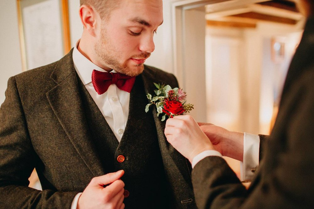Groomsman with red rose buttonhole
