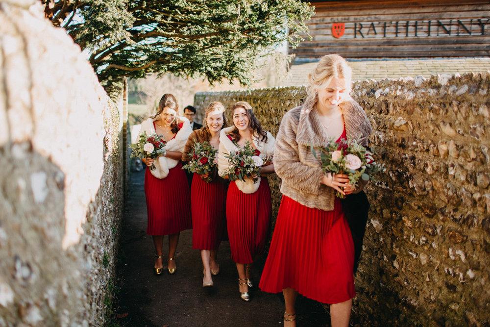 Winter bridesmaids walking to church