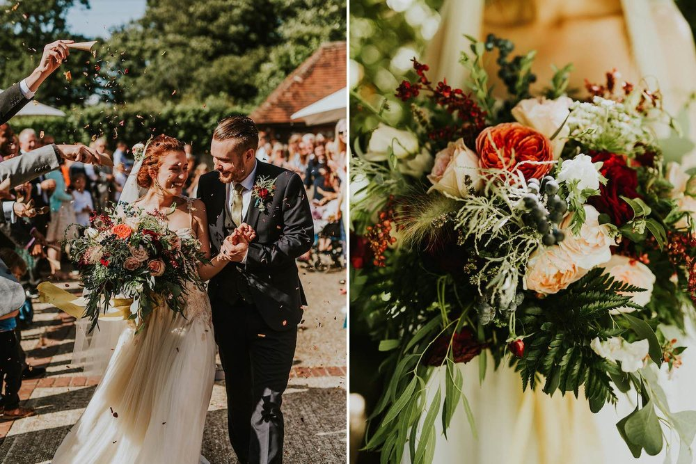 Woodland bride and groom arrive at barn reception with bouquet