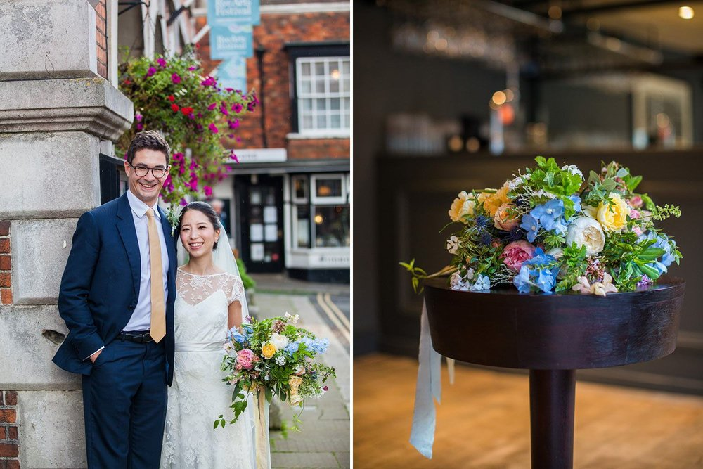 Bride and groom in Rye with flowers
