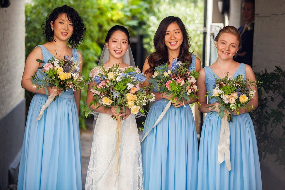Japanese bride and bridesmaids in blue with garden bouquets