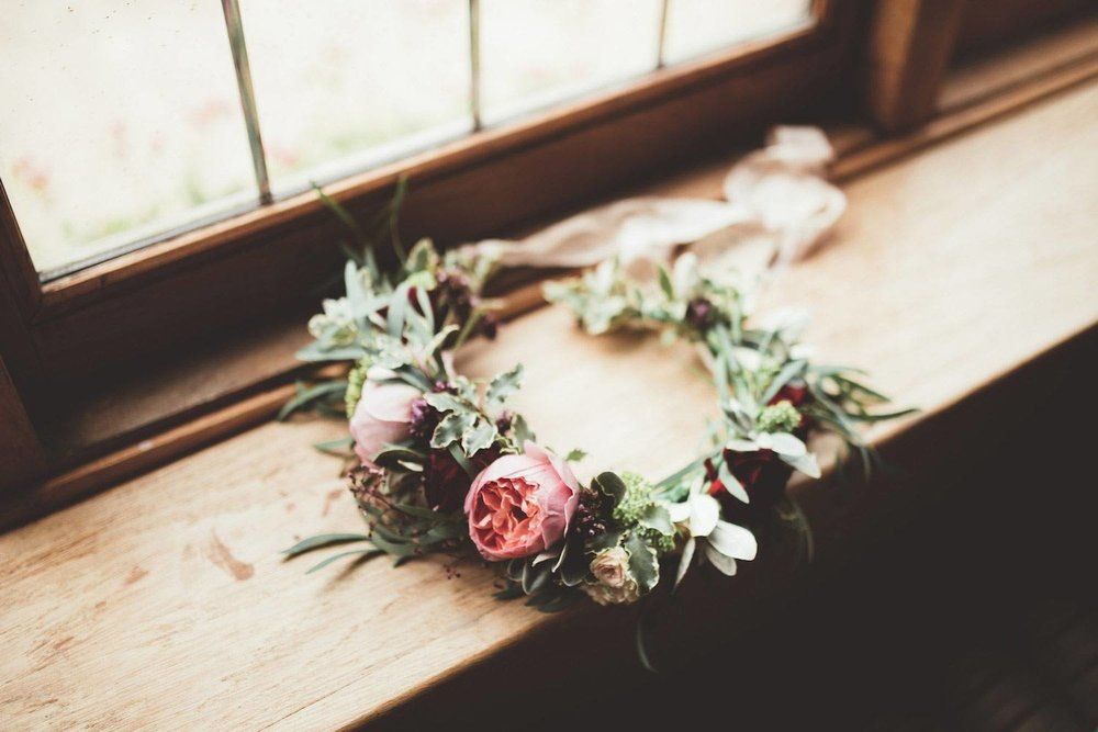 Natural rose flower crown on window sill