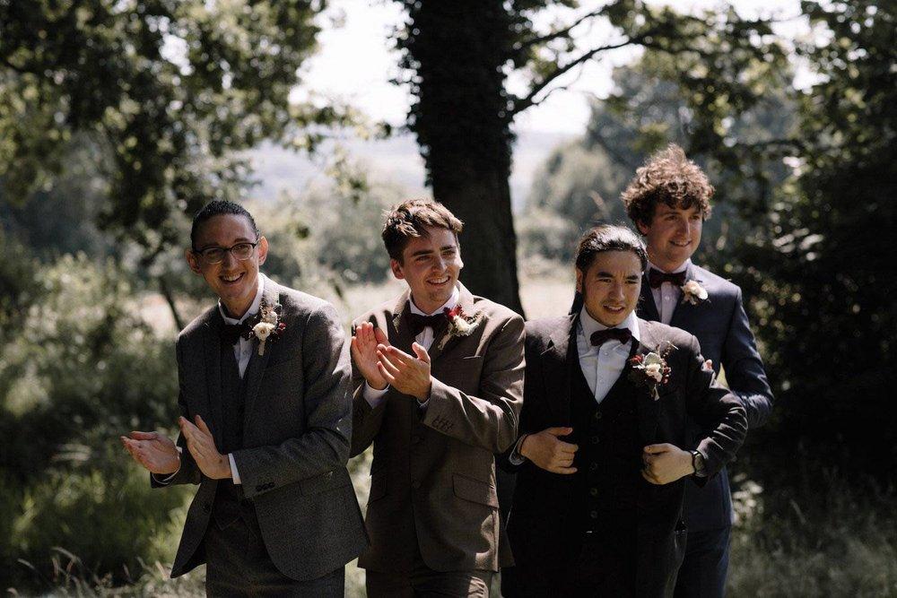 Groomsmen in woodland wedding