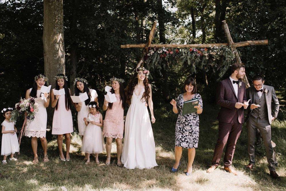 Family in woodland wedding ceremony