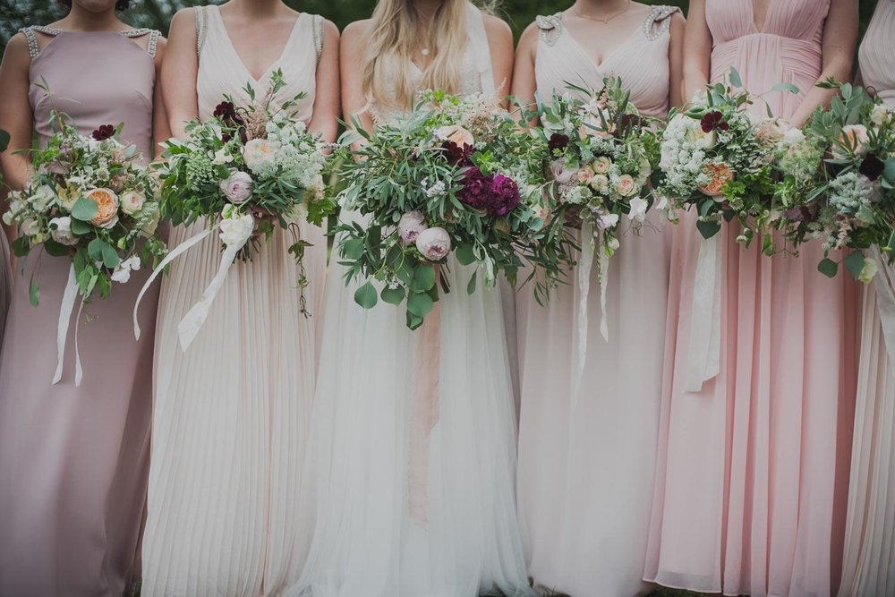 Pale pink bridesmaids with garden rose bouquets