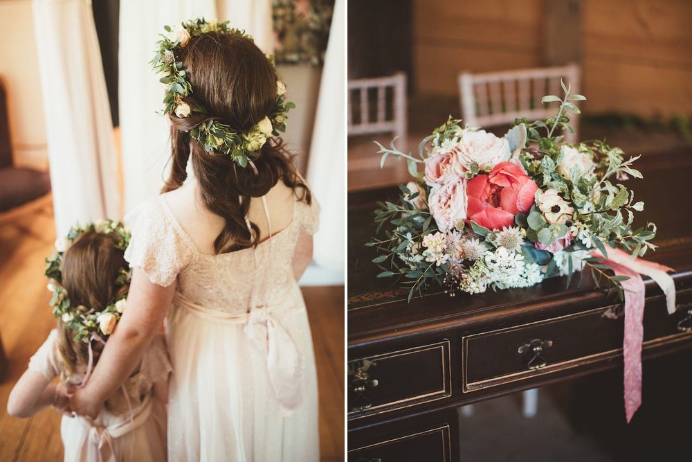 Flower girls with flower crowns and coral bridal bouquet on table