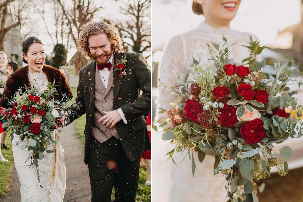 Bride and groom with red winter bridal bouquet outside church