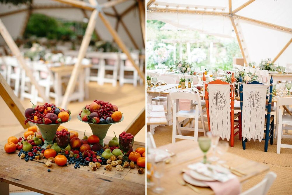 Fruit laden wedding table and marquee tables with flowers