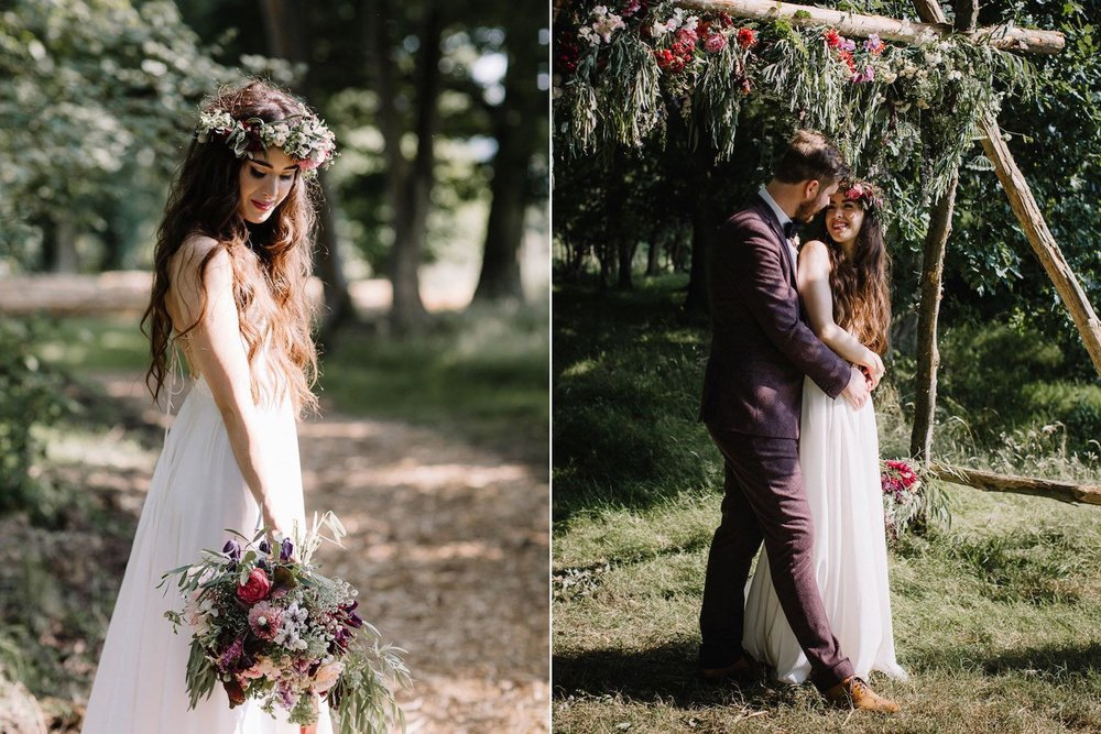Woodland bride with flower crown and bouquet with groom under ceremony arch
