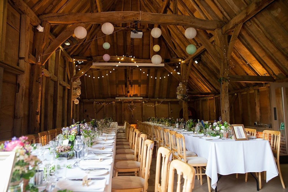 Barn wedding reception botanically styled tables