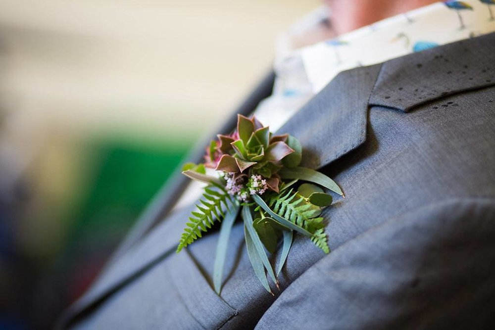 Buttonhole with ferns and wild flowers