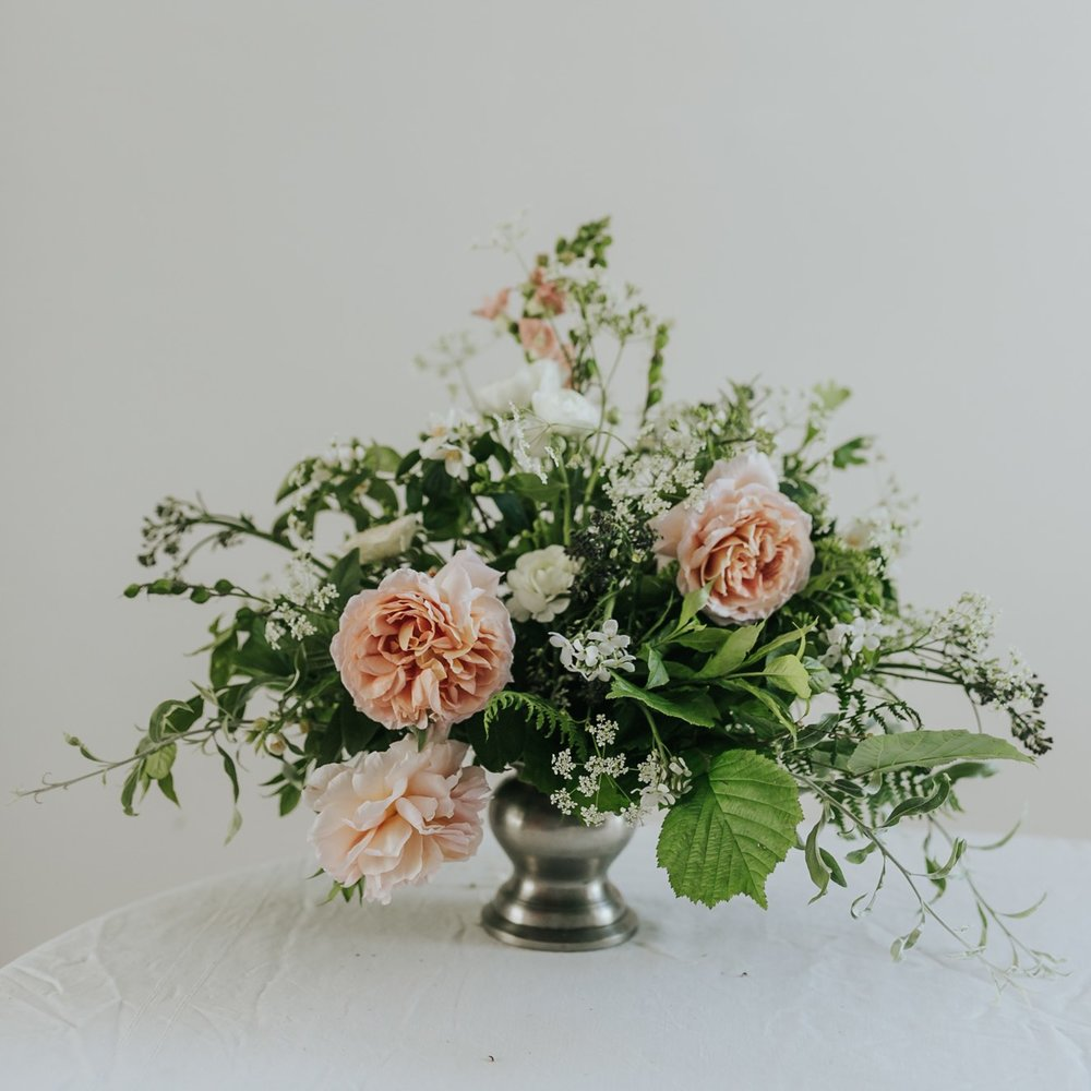 Peach roses and foraged summer flowers table centrepiece