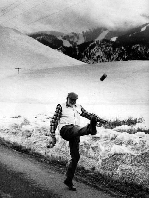 Ernest Hemingway kicking a beer can    More extremely silly pictures of extremely serious writers  here .