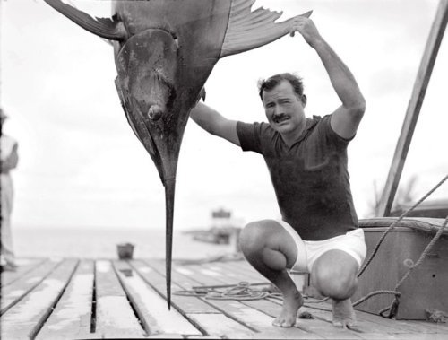 Hemingway with a sword fish and an awesome mustache.   (via: bizzlenizzle )