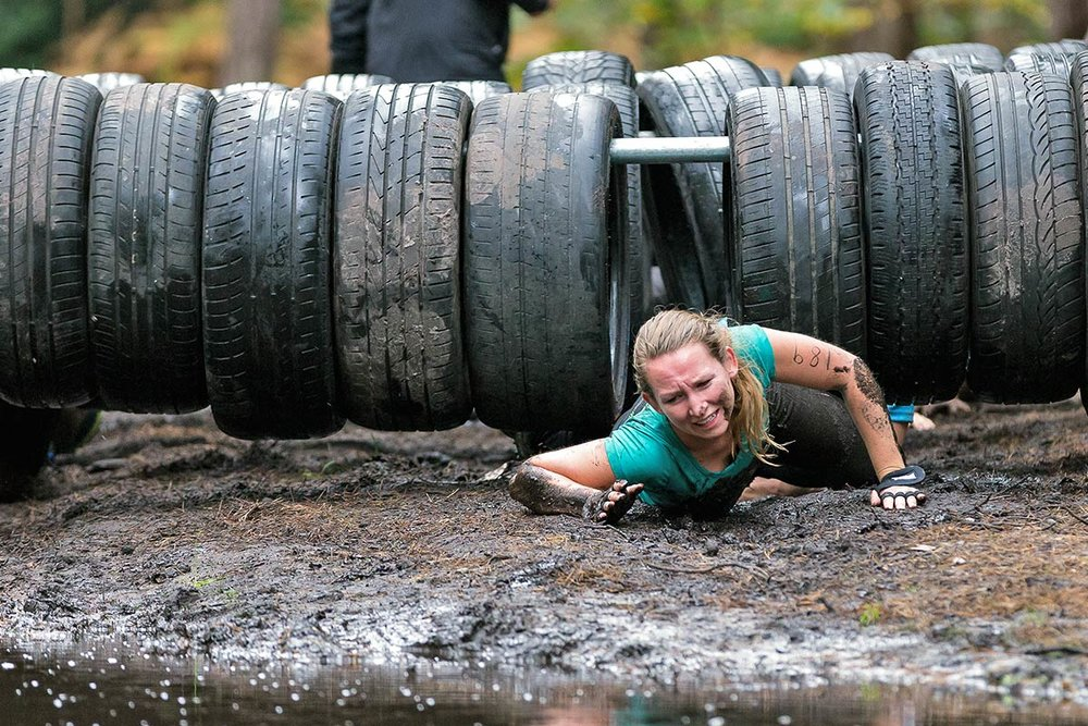 Crawling under the tyres and in the mud