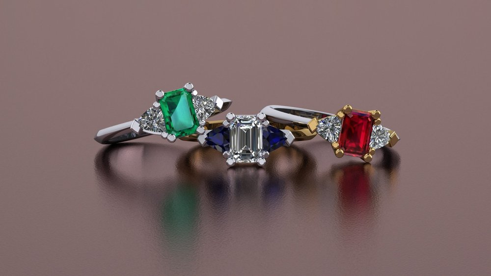Platinum, gold, diamond, emerald, sapphire, and ruby rings