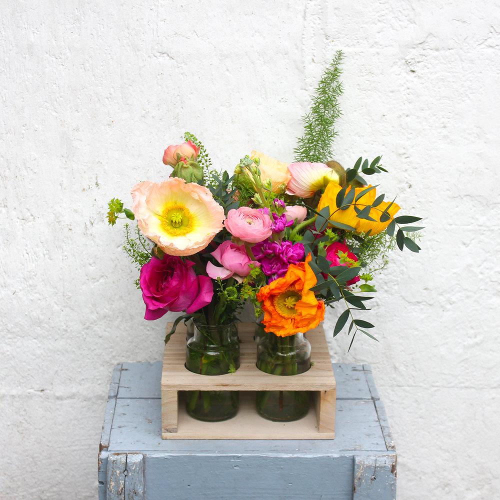 """Juno"", a vibrant poppy bottle set named after a Roman goddess of Spring"