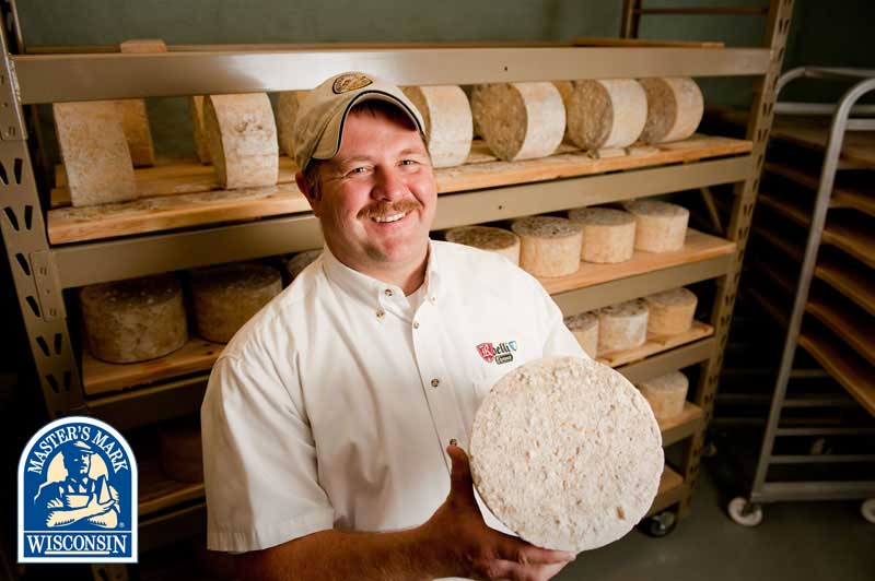 Chris Roelli Is justifiably proud of his cheese.