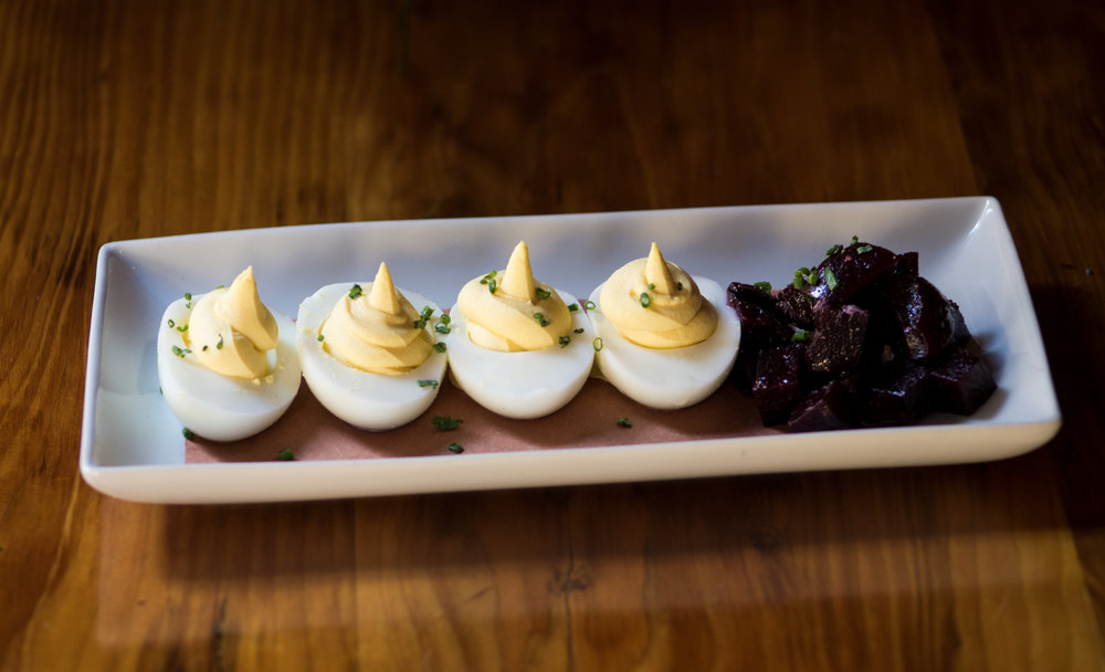 Black Truffle Deviled Eggs  truffle-balsamic marinated beets, chive