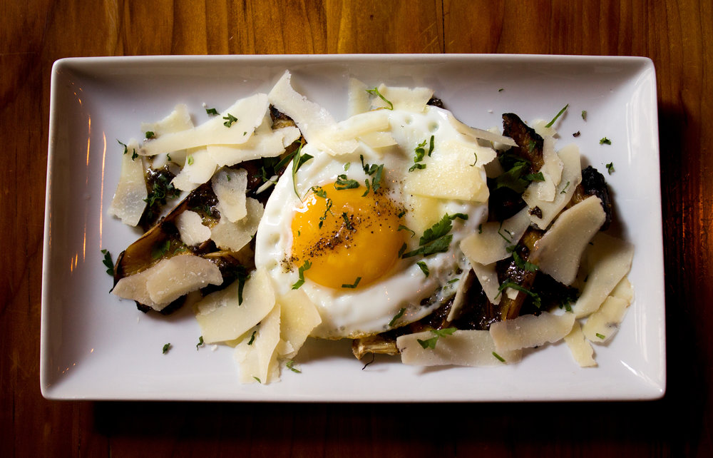 King Oyster Mushrooms  fried egg, truffled black trumpet vinaigrette, shaved parmesan