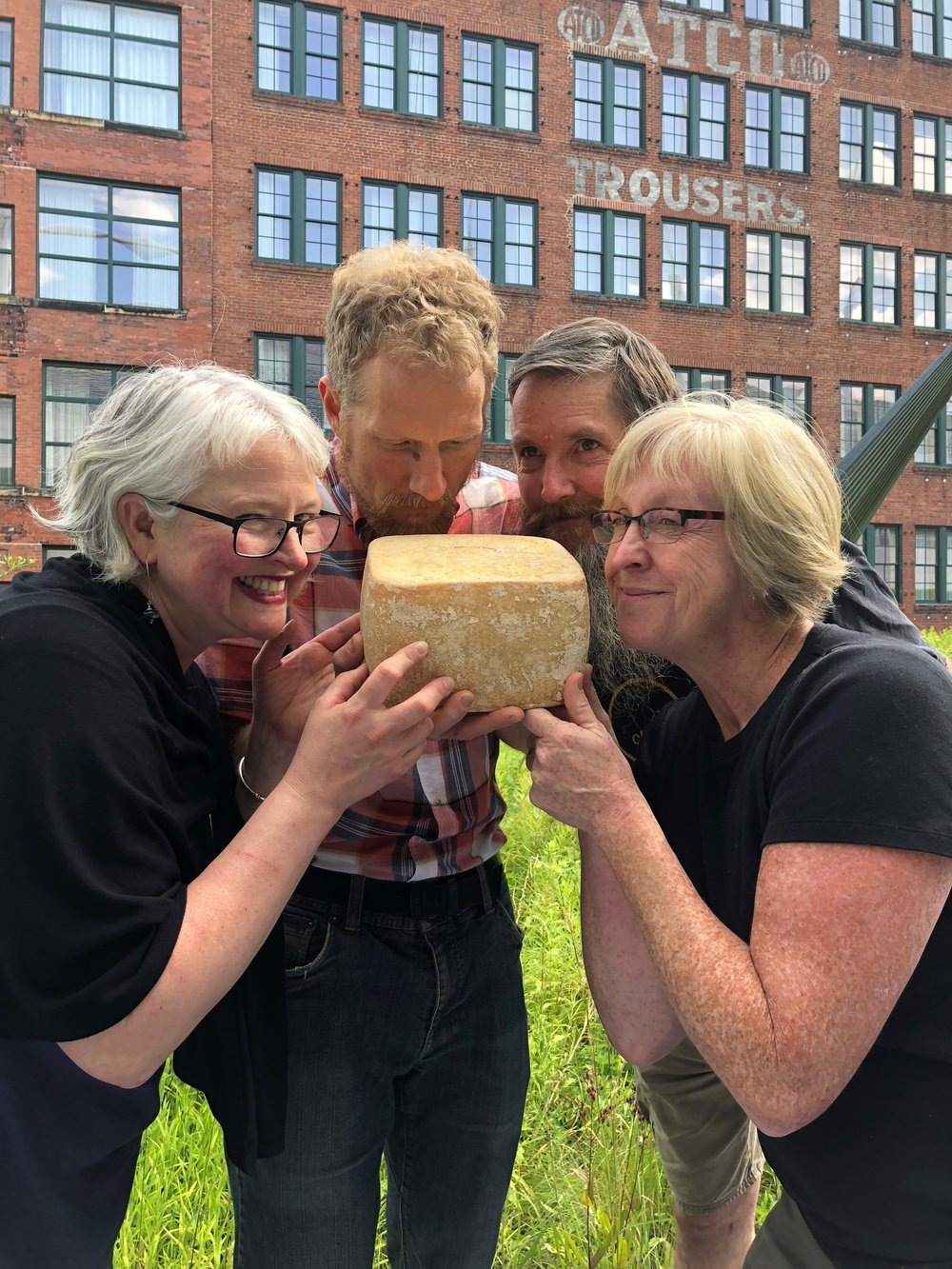 """Four very proud cheesemakers with one of the first Cornerstone American cheese """"stones""""…! Photo Credit: Tenaya Darlington"""