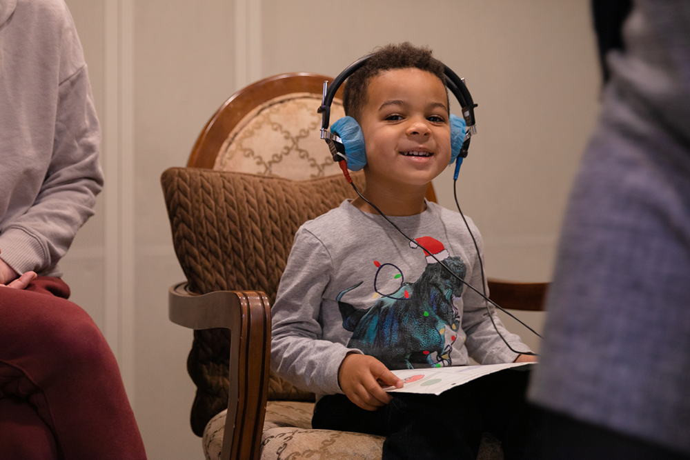 A child taking a hearing test