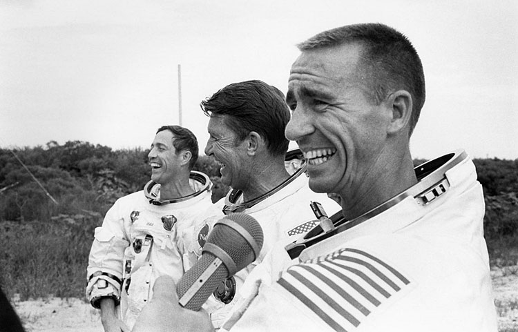 The Apollo 7 astronauts answer questions following an emergency egress training session. September 9, 1968. Photo Credit: NASA. Scan by J.L. Pickering.