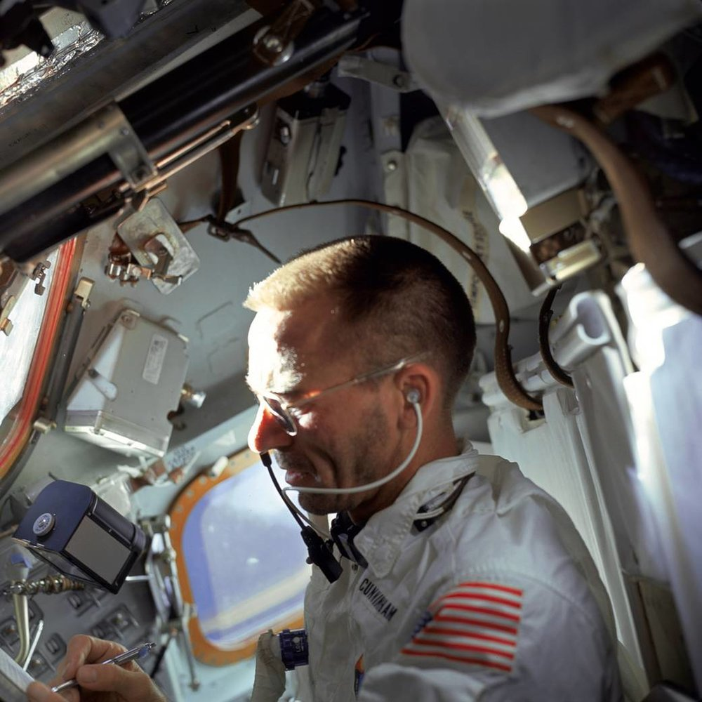 Walter Cunningham working in orbit during the flight of Apollo 7. Photo Credit: NASA.