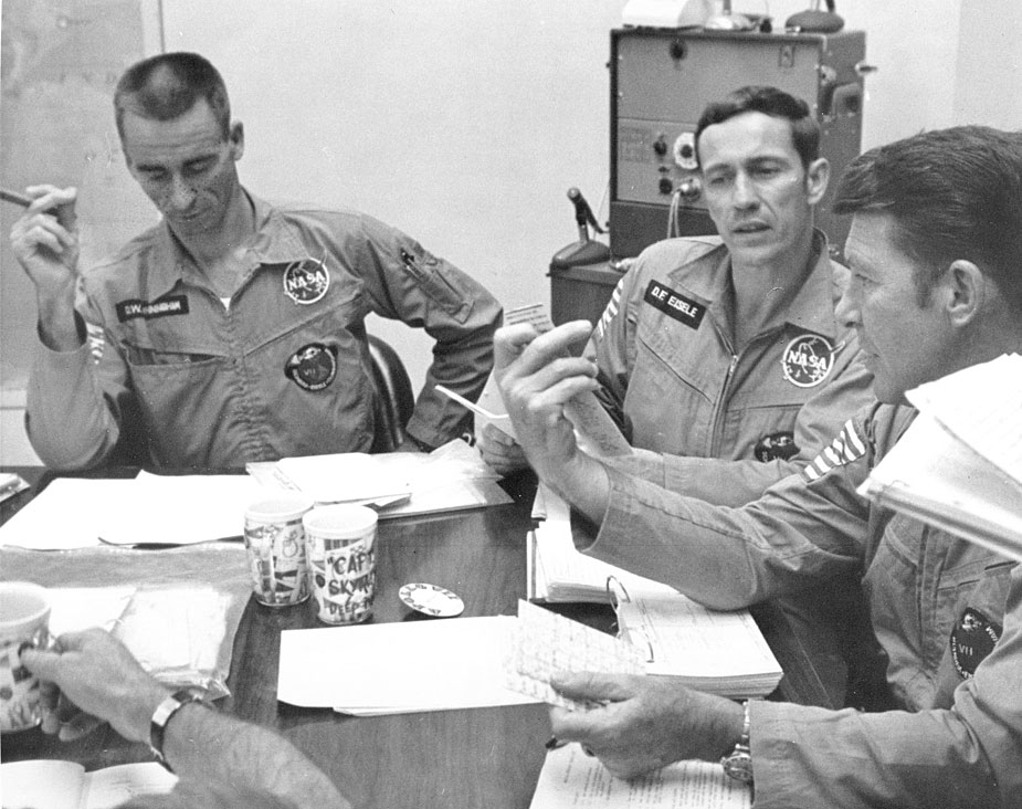 Apollo 7 astronauts (l-r) Walter Cunningham, Donn F. Eisele, and Walter M. Schirra, Jr., compare notes at a mission debriefing conducted today at the Kennedy SpaceCenter. October 23, 1968. Photo Credit: NASA. Scan by Ed Hengeveld. Caption by Kipp Teague.