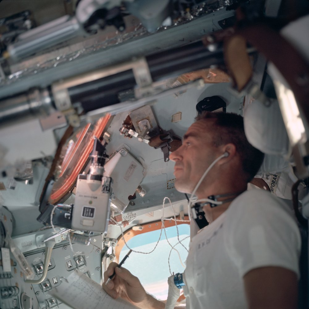Walter Cunningham at work in the CM. Photo Credit: NASA.