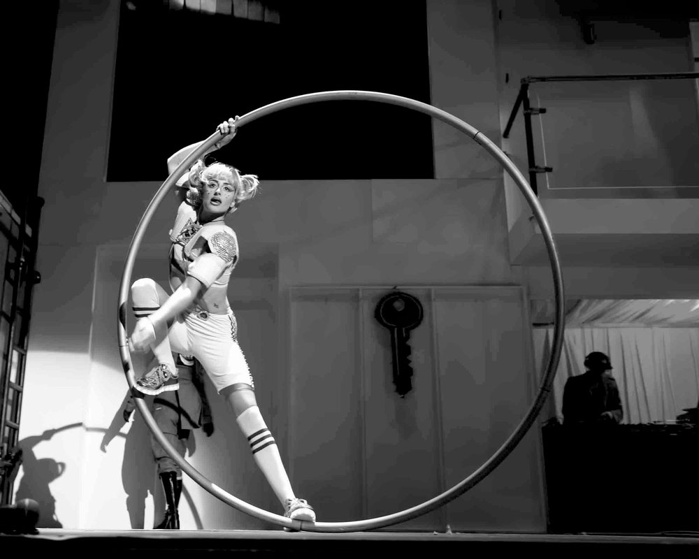 Lil Rice  is a  singer  and Cyr wheel artist based in the UK. She is a founding member of all-female Cyr wheel trio Alula Cyr and performs a singing Cyr wheel act and doubles Cyr act with her doubles partner Fiona Thornhil