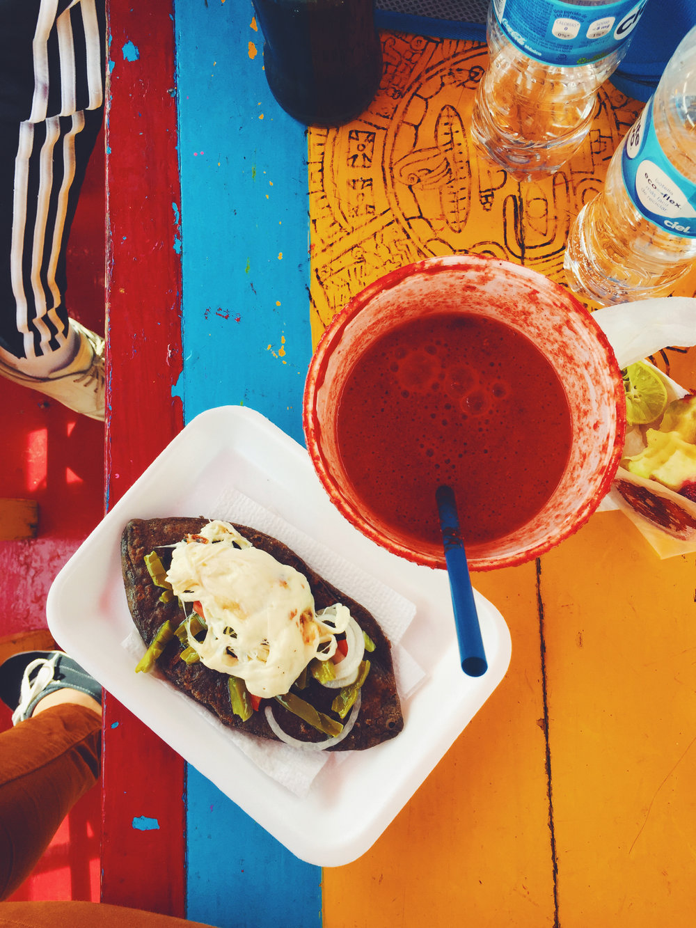 $1.50 Michelada & Tlacoyo (fried masa pocket filled with beans), cooked boatside in Xochimilco