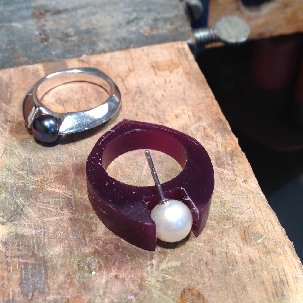 First, we carve a new wax model to fit the client's pearl.
